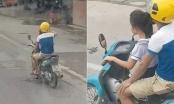 Video: Người đàn ông để bé gái cầm lái xe máy phóng như bay