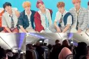 Video: Fan cuồng bám theo BTS trên máy bay?