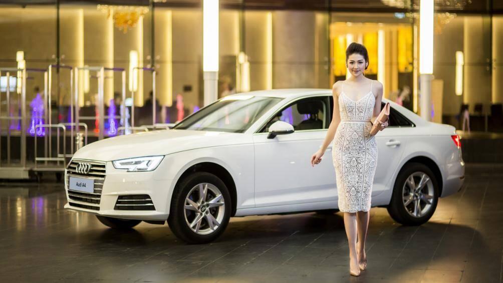 Audi A4 2016 có thiết kế cứng cáp và khoẻ khoắn kết hợp với nhan sắc dịu dàng của á hậu Tú Anh càng tăng thêm vẻ sang trọng, quý phái